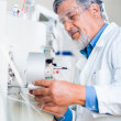 Senior male researcher carrying out scientific research in a lab — Stock Photo #18534983