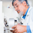 Senior male researcher carrying out scientific research in a lab — Stock Photo #18534987