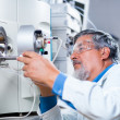 Senior male researcher carrying out scientific research in a lab — Stock Photo #18534991
