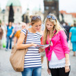 Stock Photo: Two female tourists walking along the Charles Bridge