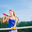 Portrait of a pretty young tennis player with copyspace — Stock Photo #18535085