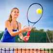 Portrait of a pretty young tennis player — Stock Photo #18535089