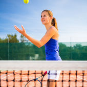 Portrait of a pretty young tennis player — Stok fotoğraf