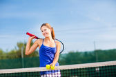 Portrait of a pretty young tennis player with copyspace — Foto de Stock