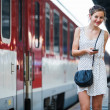 Pretty young woman at a train station - Foto de Stock
