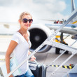 Royalty-Free Stock Photo: Departure - young woman at an airport about to board an aircraft