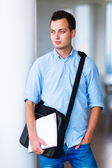 Handsome college student on campus — Stock Photo