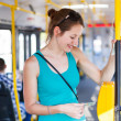 Pretty, young woman on a streetcar, tramway - Stok fotoğraf