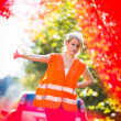 Young female driver wearing a high visibility — Stock Photo