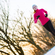 Young woman running outdoors on a cold winter day — Stock Photo