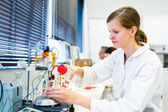 Portrait of a female researcher carrying out research in a chemistry lab — Stock Photo