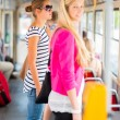Pretty, young woman on a tramway, during her commute to work - Stockfoto