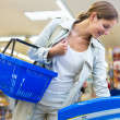 Beautiful young woman shopping in a grocery supermarket — Stock Photo #20390301