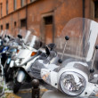Row of motorbikes and scooters parked in one of the ancient stre — Stock Photo #20390425