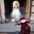 Stock Photo: Scooter parked in one of the ancient streets of Rome