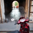 Scooter parked in one of the ancient streets of Rome — Stock Photo #20390497