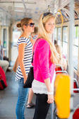Pretty, young woman on a tramway, during her commute to work — Stock Photo