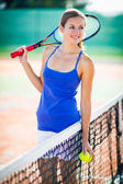 Portrait of a pretty young tennis player — Stock Photo