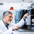 Senior male researcher carrying out scientific research in a lab — Stock Photo #22660167
