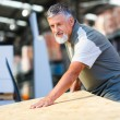 Senior man buying construction wood in a  DIY store - Foto de Stock  