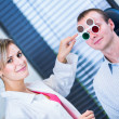 Optometry concept - handsome young man having his eyes examined — ストック写真