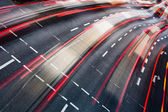 Motion blurred city road traffic (color toned image) — ストック写真