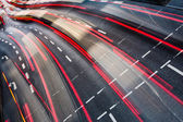 Motion blurred city road traffic (color toned image) — 图库照片