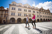 Two pretty, young women walking in the Prague historic center — Stock Photo