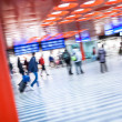 Trainstation rush: rushing to get on their train, to get — Stock Photo