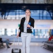 Pretty young female passenger at the airport — Stock Photo #23461462