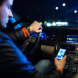 Driving a car at night -man driving his modern car at night - Stockfoto