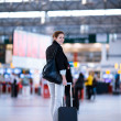Stock Photo: Pretty young female passenger at airport