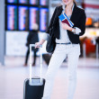 Pretty young female passenger at the airport — Stock Photo