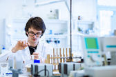 Young male researcher carrying out scientific research in a lab — Stock Photo