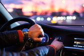 Driving a car at night -man driving his modern car at night — Stock Photo