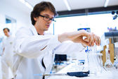 Young male researcher carrying out scientific research in a lab — Photo