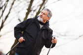 Senior man nordic walking, enjoying the outdoors — Stock Photo