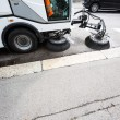 Detail of a street sweeper machine, car cleaning the road - Stock Photo