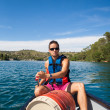 Handsome young man on a canoe on a lake, paddling, enjoying a lo — Stock Photo