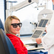 Optometry concept - pretty young womhaving her eyes examined — Stockfoto #25322037