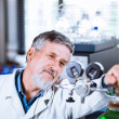 Senior male researcher carrying out scientific research in a lab — Stock Photo #29823173