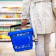 Pretty young woman buying groceries in a supermarket, mall, grocer — Stock Photo #29823761