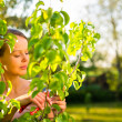 Pretty female gardener taking care of her lovely garden — Stock Photo