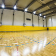 Stock Photo: Interior of modern multifunctional gymnasium with young people