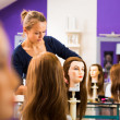Pretty female hairdresser - haidressing apprentice — Stock Photo