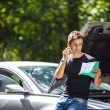 Handsome young man calling for assistance with his car broken do — Stock Photo