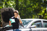 Handsome young man calling for assistance — Stock Photo