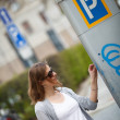 Woman paying for parking — Stock Photo #40426623