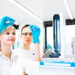Researchers carrying out experiments in a lab — Stock Photo
