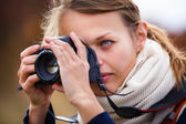 Amateur photographer taking photos — Stock Photo